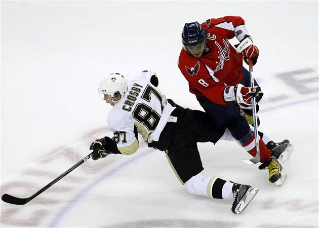 (8), of Russia, runs into Pittsburgh Penguins' Sidney Crosby (87