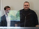 Zaměstanci firmy Megaupload.com u soudu v novozélandském Aucklandu: (zleva) Bram van der Kolk, Finn Batato  Mathias Ortmann a zakladatel Kim Dotcom, známý také jako Kim Schmitz či Kim Tim Jim Vestor (20. ledna 2012)