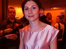 7. místo � Martha Issová, here�ka  Výrazná �ernovlasá a kudrnatá dívka je�t�...