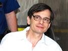 Justiční stráž přivádí falešného šlechtice Karla Šimko. (22. března 2012)