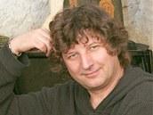 Petr Malásek a jeho oblíbený hudební nástroj - klavír.