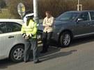 Pražský lobbista a podnikatel Roman Janoušek stojí u svého Porsche Cayenne...
