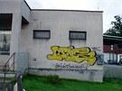 Graffiti na břizolitové omítce