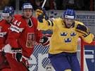 VEDOUCÍ TREFA. Henrik Zetterberg slaví první �védský gól, �e�tí hokejisté...