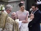 Švédská princezna Victoria a její manžel Daniel Westling na křtu princezny