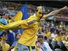 SUPERMAN. Ukrajinský fanou�ek pózuje jako Superman.