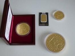Zlaté medaile, investiční mince a slitek.
