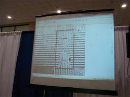 Zvětšená aréna (rozměry 4 mm na délku) a mřížka pro dielektroforetickou (DEP)...