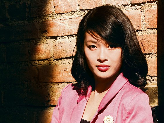 Here�ka Ha Thanh Nguyenov�. Sestra Tien z Ordinace v r�ov� zahrad�.