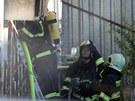 Na tržnici v brněnské Olomoucké ulici hořela hala. Stovka hasičů bojovala s
