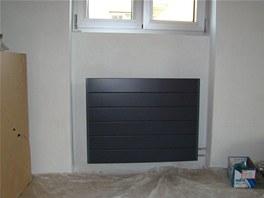 V kuchyni byl instalovánkonvektor do obvodové zdi do předem vybudované niky.