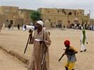 Příslušník islamistického hnutí Ansar Dine svolává obyvatele Timbuktu k