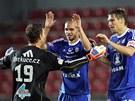 Olomoučtí fotbalisté (zleva) Martin Blaha, Michal Vepřek a Aleš Škerle se radují z výhry nad Spartou.