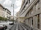Původní návrh počítal s osmipatrovým domem, v němž měl být hotel.