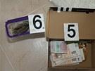 Peníze nalezené v souvislosti ze zpronevěřením výhry bezdomovce.