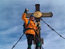 Autor na vrcholku střechy Rakouska
