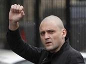 Ruský opoziční aktivista Sergej Udalcov přichází k výslechu. (26. října 2012)