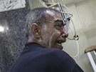 Obyvatel Aleppa zraněný při vládním ostřelování (2. listopadu 2012)