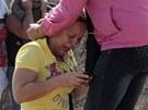 Příbuzní vězňů z venezuelské věznice Uribana oplakávají své blízké (26. ledna