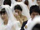 Tis�ce �len� c�rkve MOonist� se v ned�li sjeli do Ji�n� Koreji na svatbu  (17.