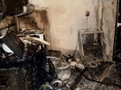 Tohle zbylo z kuchyně bytu, kde vypukl požár. (4.3.2013)
