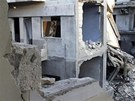 Trosky v centru syrského města Homs (25. března 2013)