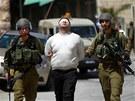 Vojáci zadrželi palestinské aktivisty, kteří pochodvali ulicemi Hebronu.