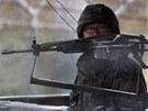 Jihokorejský voják na hranicích s KLDR (11. března 2013)