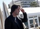 Keanu Reeves pod palbou fotografů