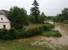 ���ka Trnava vyplavila v Ho�epn�ku na Pelh�imovsku zahrady a asi des�tku dom�