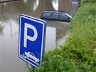 Po přívalovém dešti v neděli 9. června dosahovala hladina vody v Pobřežní ulici