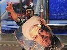 Umírněný duchovní Hasan Rúhání (na plakátu) je novým íránským prezidentem....