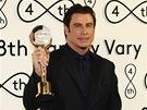 Herec John Travolta s K�i���lov�ch gl�bem na zah�jen� 48. ro�n�ku mezin�rodn�ho