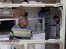 Následky atentátu v iráckém Kútu (14. července 2013)