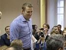 Ruský opozičník Alexej Navalnyj si ve čtvrtek vyslechl u soudu verdikt vinen v