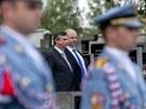 Minist�i Jan Fischer a Martin Pecina p�i pietn�m aktu nov� vl�dy u hrobu Tom�e...