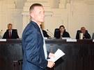 Lobbista Roman Janoušek se před pražským městským soudem omluvil ženě, kterou