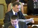 Expremiér Petr Nečas (ODS) sedí v poslanecké lavici při jednání Sněmovny. (17.