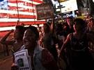 V ulicic�h velk�ch m�st USA pochodovali lid�, kte�� protestovali proti