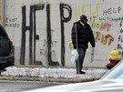 Volání  o pomoc na zdi v americkém městě Detroit. (Detroit, prosinec 2008)