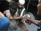 Muž vytažený z trosek v Homsu (29. července 2013)