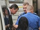 Policejn� eskorta p�iv�� ke Krajsk�mu soudu v Praze Davida Ratha. (3. z���...