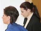 Policistka p�iv�d� ke Krajsk�mu soudu v Praze Kate�inu Pancovou. (3. z��� 2013)