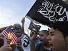 V libyjském přístavu Benghází v úterý protestovalo několik desítek lidí proti...