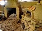 Rumfordův krb a hliněná pec na pizzu zastupují ve venkovní kuchyni ohnivý