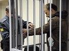 Na lavici obžalovaných u soudu v Murmansku usedl i ukrajinský fotogra Denis...
