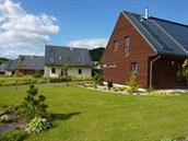 Unikátní pilotní projekt hromadné výstavby pasivních domů vyrostl v roce 2007...
