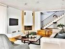 Interiér je pojatý převážně ve světlých přírodních barvách.