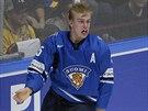 Finští hokejoví junioři se radují z titulu mistrů světa. Vlevo autor vítězného...
