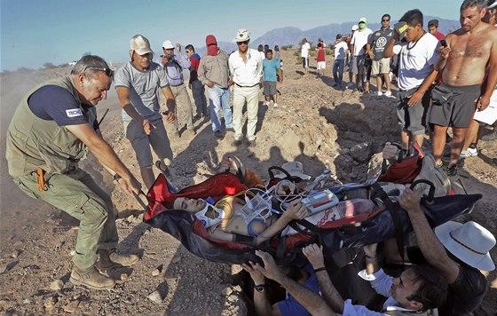 Gilbert Escalé po nehodě na Rallye Dakar. U jeho záchrany pomáhal i ředitel